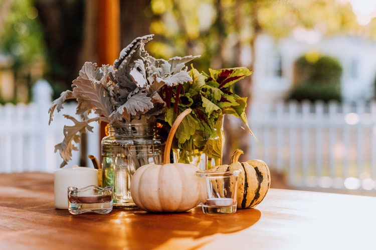 Two pumpkins on a table for decoration.